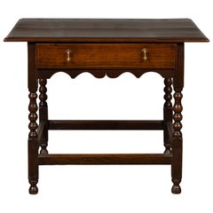 English 1870s Oak Side Table with Single Drawer, Turned Legs and Carved Apron