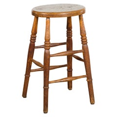 English 1880s Elm Stool with Oval Seat, Turned Splaying Legs and Side Stretchers