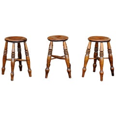 English 1880s Elm Stools with Turned Legs and Spindle-Shaped Cross Stretchers