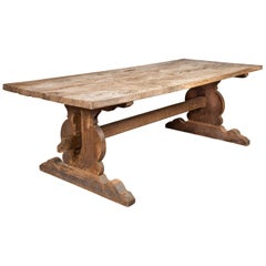English 1880s Oak Farm Dining Table with Carved Trestle Base and Aged Patina