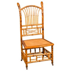 English 1890s Bamboo Slipper Chair with Fan Back, Rattan Seat and Casters