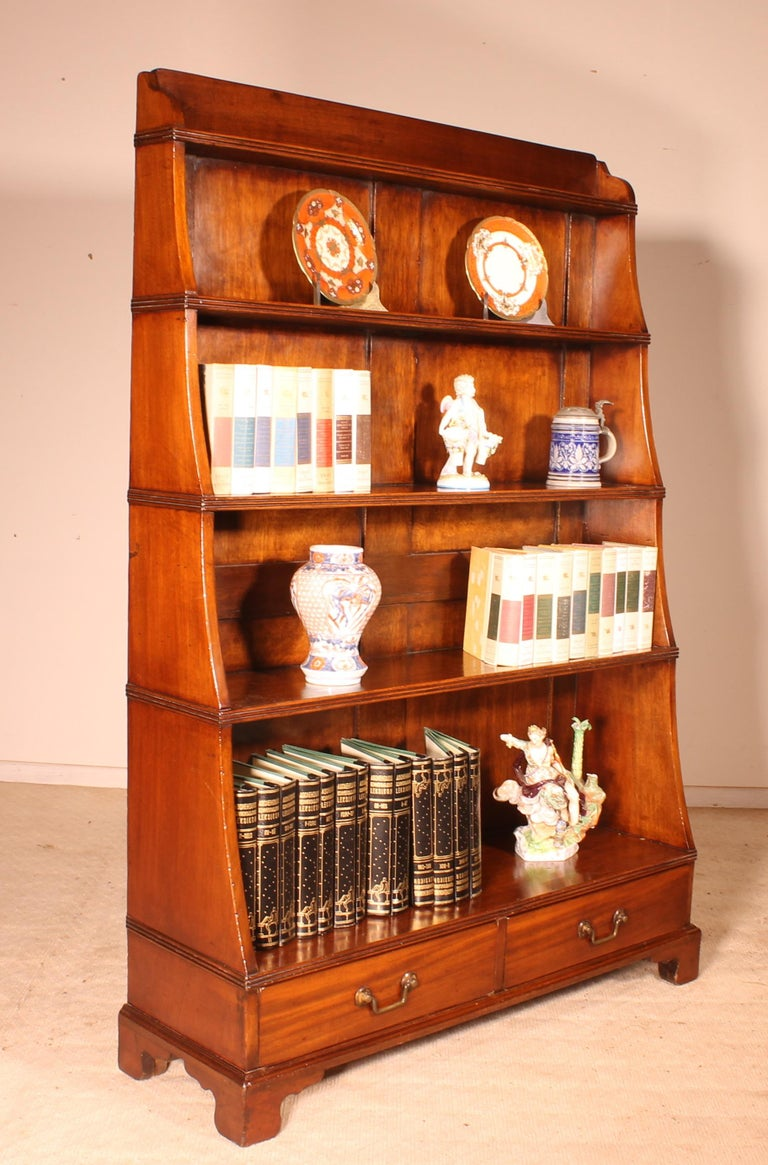 Beautiful English open bookcase called waterfall of the 19th century beautiful mahogany bookcase that has two drawers at the bottom and 5 levels The levels decrease from the bottom to the top. This give the bookcase a nice line and makes the