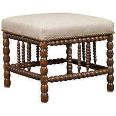 English 1900s Oak Footstool with Bobbin Legs, New Upholstery and Nailhead Trim
