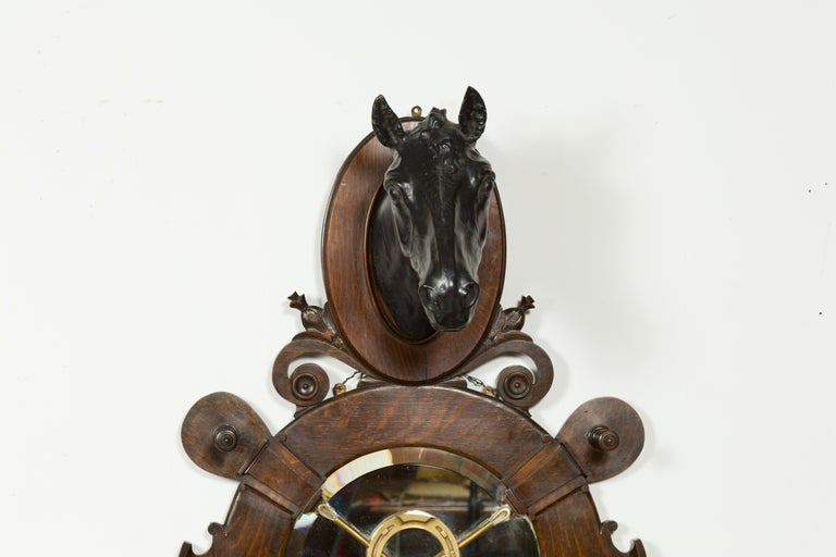 An English wall hanging terracotta and oak horse with bronze accents, signed J. Priestman Sculptor circa 1903 and titled The Count. Created in the early years of the 20th century, this wall hanging fixture features a black terracotta horse head on