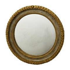 English 1920s-1930s Carved Wooden Round Mirror with Gilt Accents and Foliage
