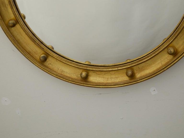 English 1920s-1930s Giltwood Bullseye Convex Girandole Mirror with Small Spheres In Good Condition For Sale In Atlanta, GA