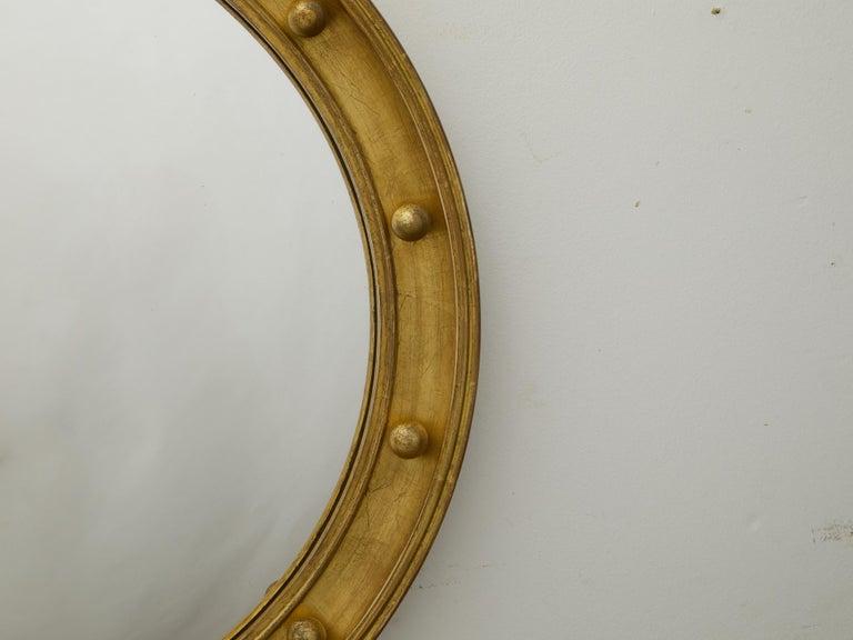 English 1920s-1930s Giltwood Bullseye Convex Girandole Mirror with Small Spheres For Sale 1