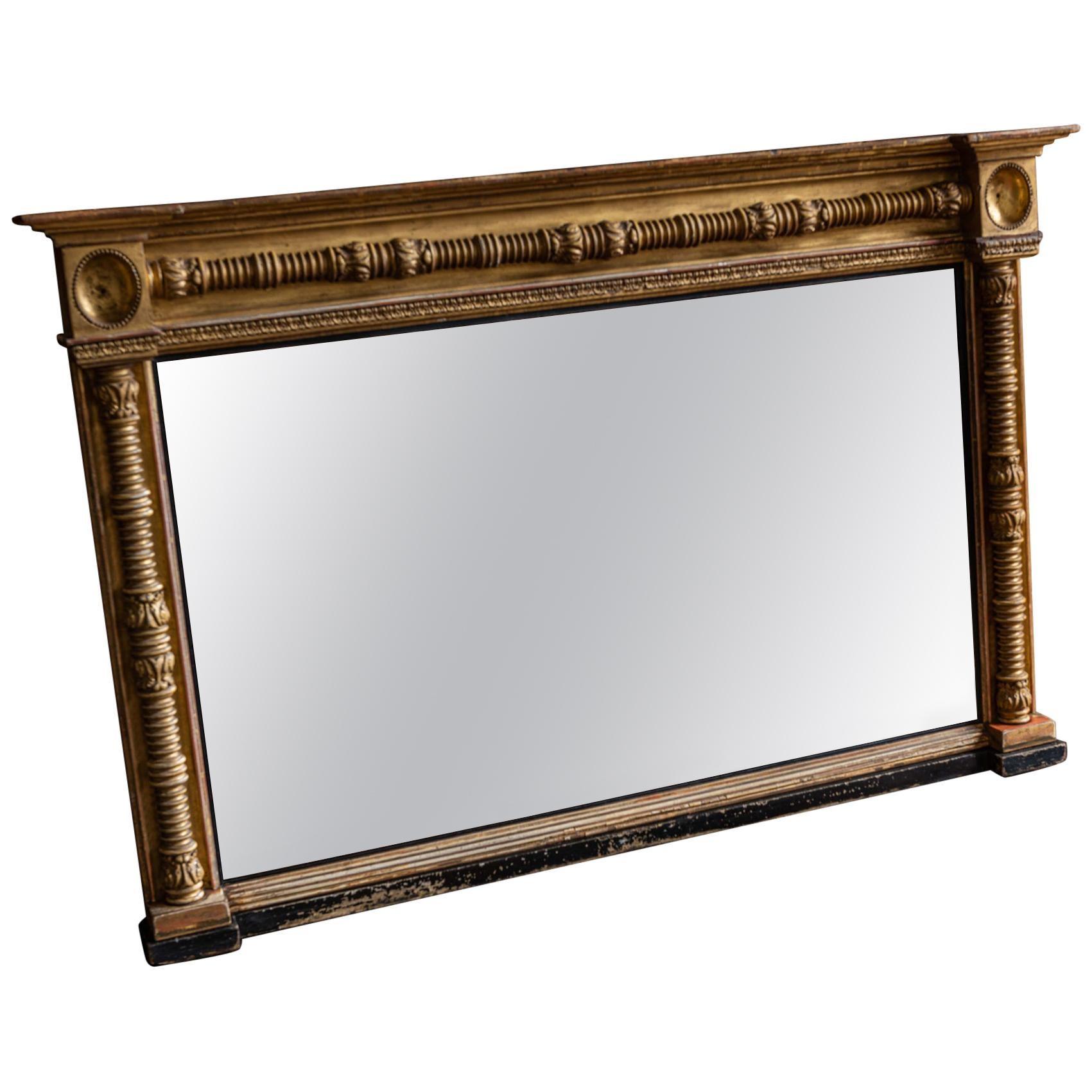 English 19th Century Gilt and Ebonized Bevelled Overmantle Mirror
