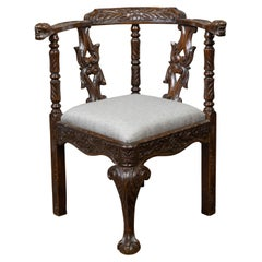 English 19th Century Oak Corner Chair with Carved Foliage and New Upholstery