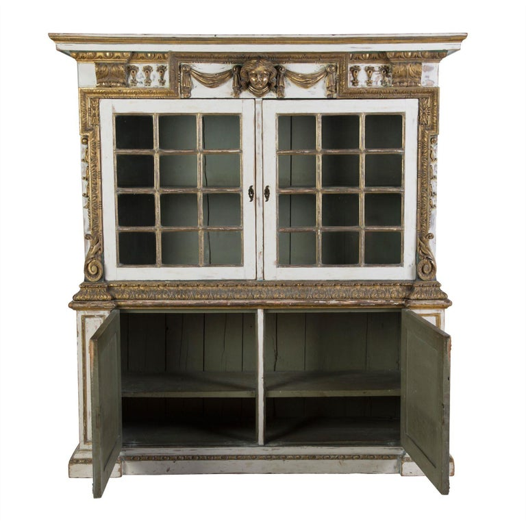 English 19th century Kentian style cupboard with gilded, carved wood details.
