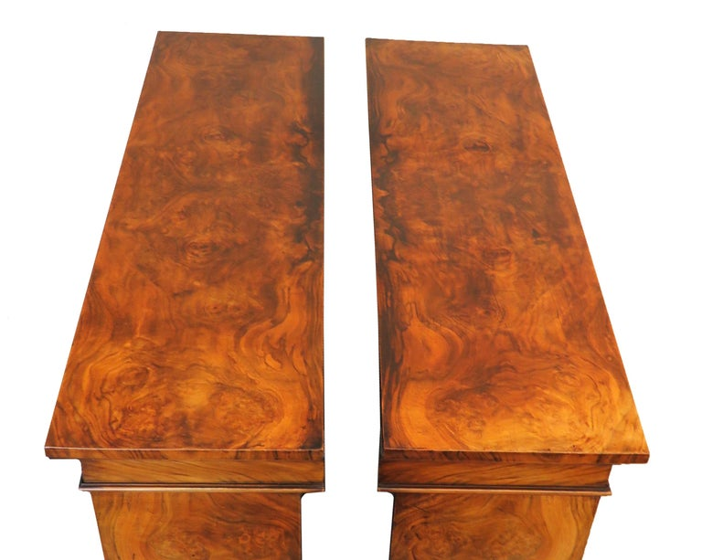 A fine quality pair of mid-19th century English burr walnut dwarf open bookcases of good proportions having superbly figured rectangular tops over adjustable shelves and extremely well figured ends raised on original plinth bases.  (These