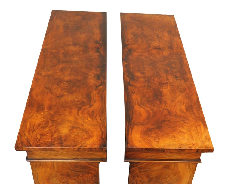 A fine quality pair of mid-19th century English burr walnut dwarf open bookcases of good proportions having superbly figured rectangular tops over adjustable shelves and extremely well figured ends raised on original plinth bases  (These