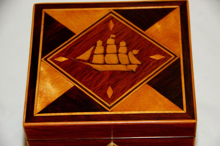 English Early 19th century partridgewood single tea caddy with three masted, square rigged ship inlaid to the lid. The ship is inlaid in shaded boxwood within a partridgewood diamond cartouche with satinwood diamonds in each corner and geometric