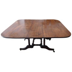 English 19th Century Stained Elm and Mahogany Drop-Leaf Table on 4 Iron Castors