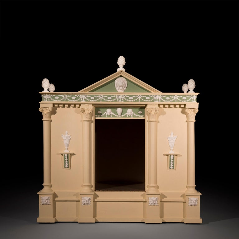 A very unusual, large and Fine architectural dog kennel, modeled as a neoclassical temple, Possibly English, circa late 19th-early 20th century.  Of architectural form, with pineapple finials and lion mask mounted pediment, above the festive