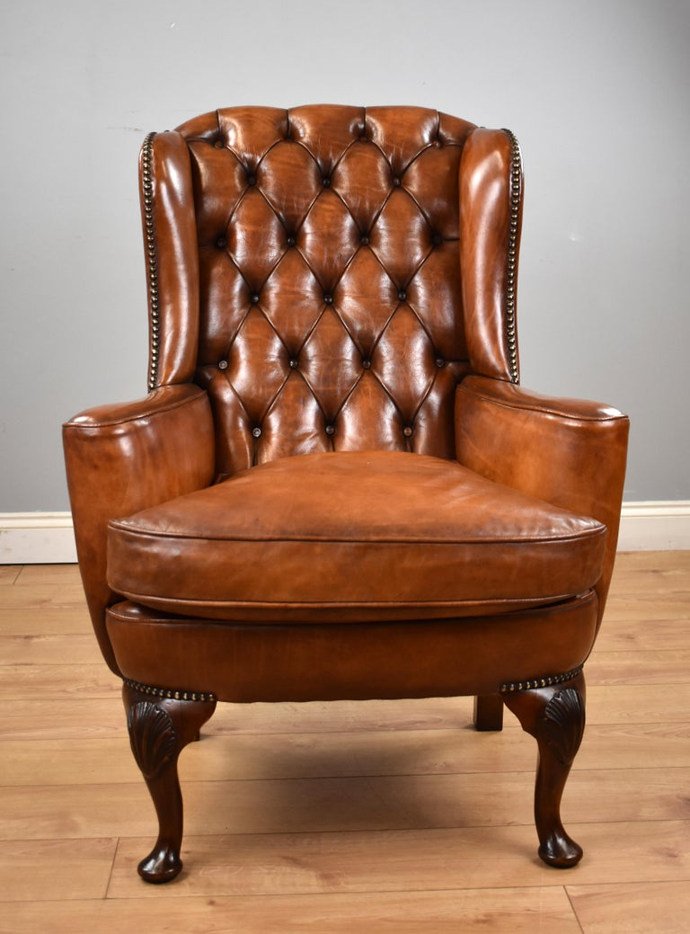 For sale is a good Victorian hand dyed leather wingback armchair, having a deep buttoned back flanked by a wing on either side, above a cushion with two sweeping arms. The chair stands on elegant cabriole legs with a carved shell on each knee and is