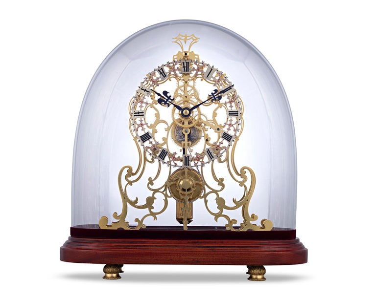 This exceptional arabesque skeleton clock is a stellar example of English clockmaking from the preeminent English firm of Evans of Handsworth. The complex timepiece incorporates both an unusual, oversized dial and a complex 8-day triple plate