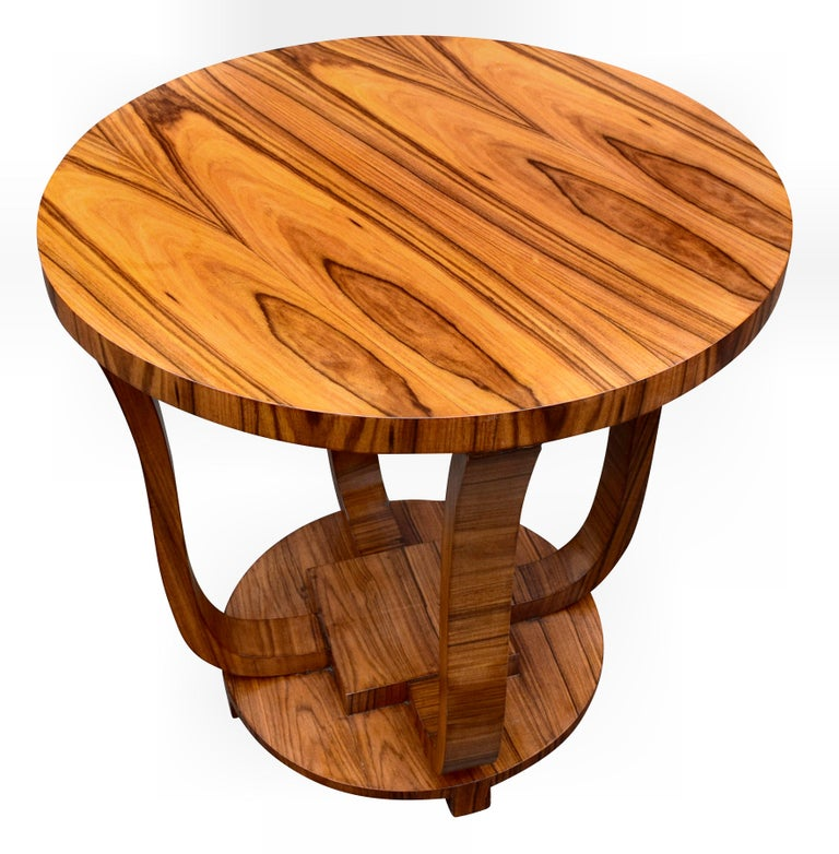 Very stylish and totally authentic English Art Deco walnut centre table dating to the 1930s. This table is beautifully shaped and fully restored to showroom condition. Typically larger than occasional coffee tables, these make ideal pieces to make a