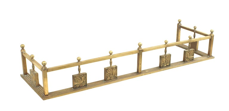 Turn of the century English Arts and Crafts brass fire place fender with six panels showing different breeds of birds.