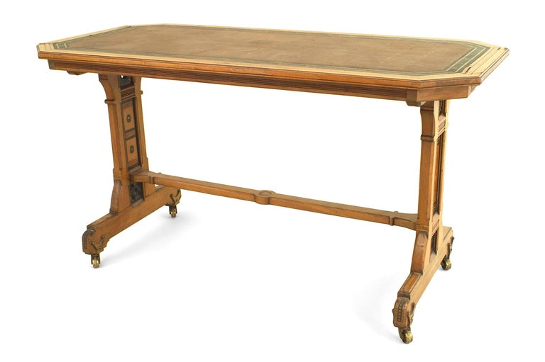English Arts & Crafts (Aesthetic Movement) double pedestal table elm and burl wood desk with a canted corner top having multi-wood inlay and a green & brown leather writing surface.