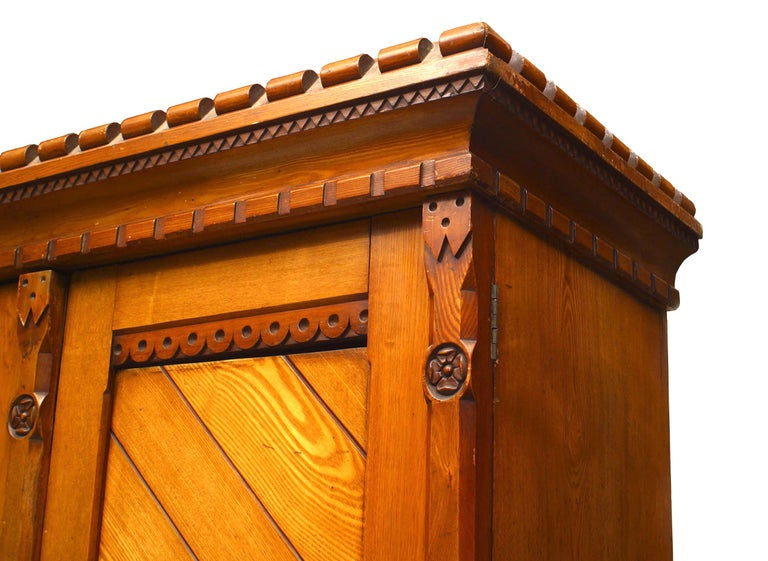 English Arts & Crafts Carved Pine Armoire In Good Condition For Sale In New York, NY