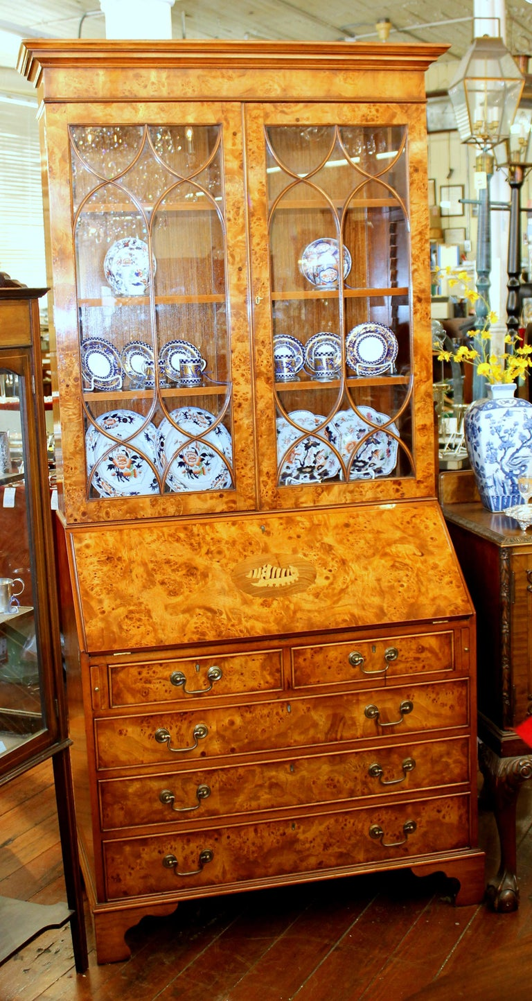 Exceptional quality English bench-made inlaid burr elm Chippendale style bureau bookcase/ secretary with handsome fitted interior and leather surface