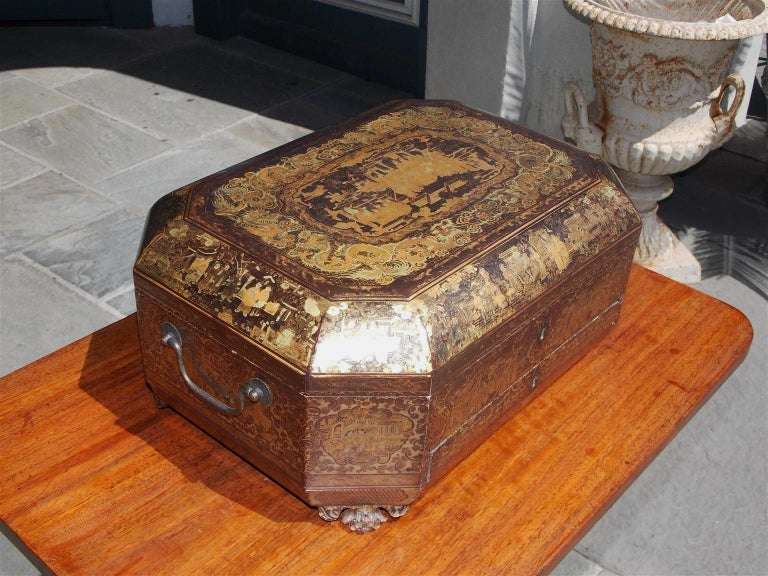 English octagonal black lacquered and gilt stenciled figural pagoda hinged one drawer sewing box with exterior gilt stenciled dragon motif, interior gilt stenciled floral motif, original brass side handles and terminating on the original gilt winged