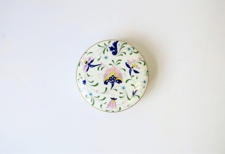 A beautiful English Coalport Porcelain predominantly blue and white 'botanical' decorated round box. Box can hold jewelry, trinket or other small items. Beautiful floral and leaf design with colors that include: dark blue, light blue, green, yellow,