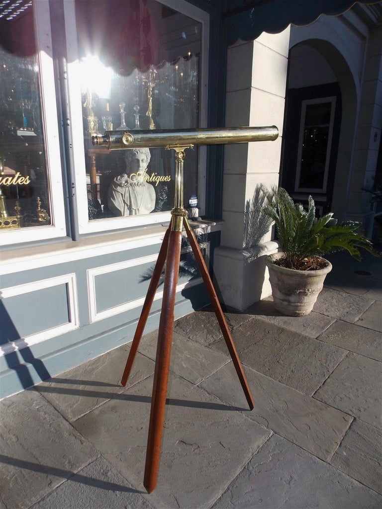 English British colonial telescopic brass-mounted telescope on walnut tripod stand with the original carrying case. Telescope is in working condition, Late 19th century.