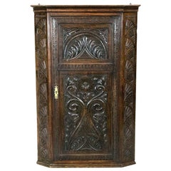English Carved Oak Hanging Corner Cupboard
