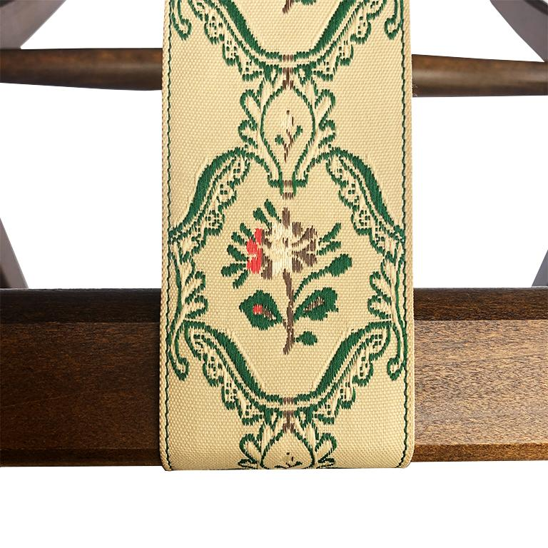 Chintz floral folding stained wood luggage rack. Composed of stained wood, and three chinoiserie chintz floral straps in green, pink and cream. Folds for easy storage. Wonderful to add to a guest room, or for a patio to place a tray while