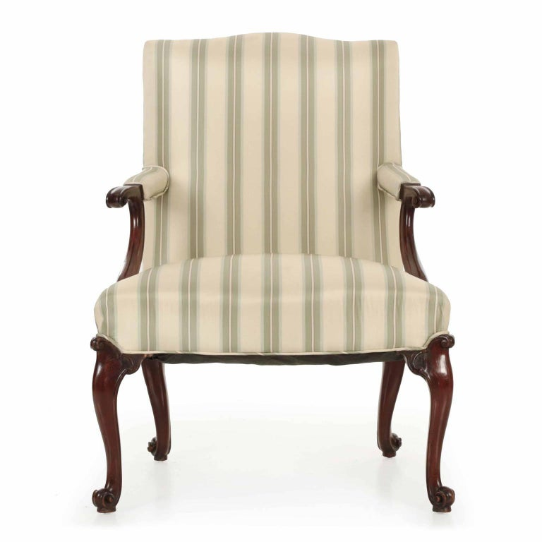A dramatic and bold armchaircrafted during the last quarter of the 18th century in England, the chair exhibits a forward motion that is powerful and most striking. The essence of the rocaille is captured in the scrolling knee returns and the intense