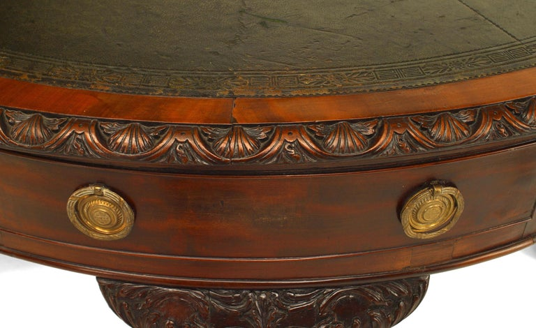 English Chippendale style (18/19th Century) mahogany landlord style drum design center table with 4 drawers and round green leather top.