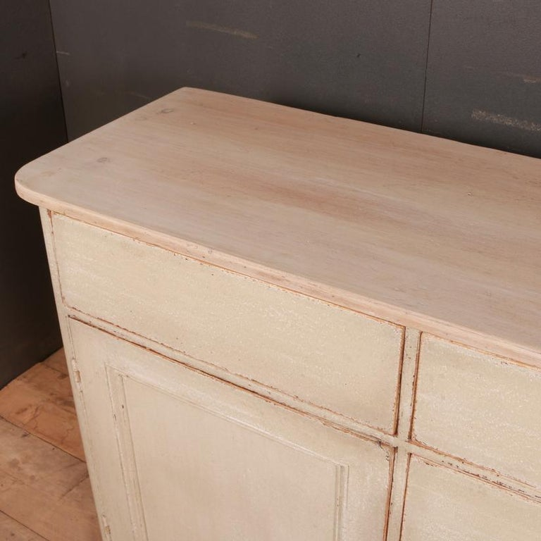 19th century English painted country house dresser base with a pale pine top. Awaiting handles, 1820.  Dimensions 74.5 inches (189 cms) wide 19 inches (48 cms) deep 36 inches (91 cms) high.
