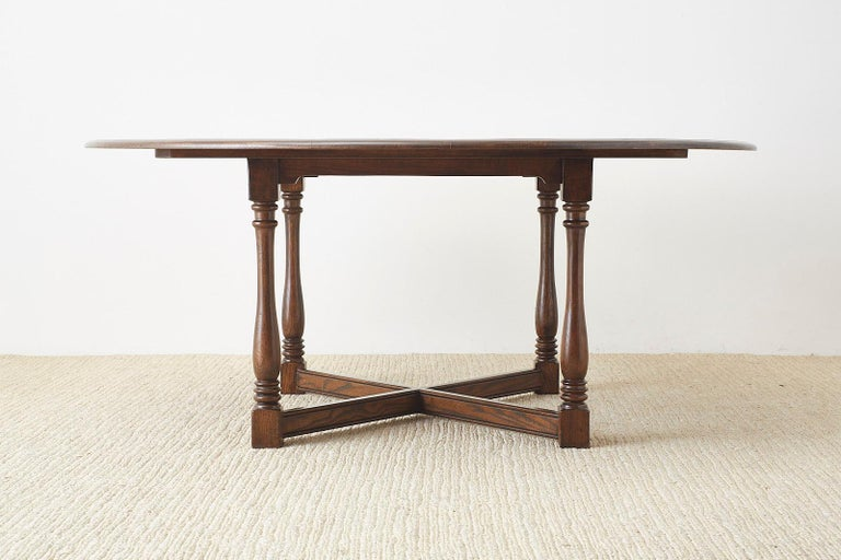 20th Century English Country Style Round Oak Dining Table For Sale