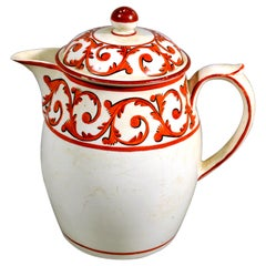 English Creamware Covered Jug and Cover with Orange Foliate Scroll Designs