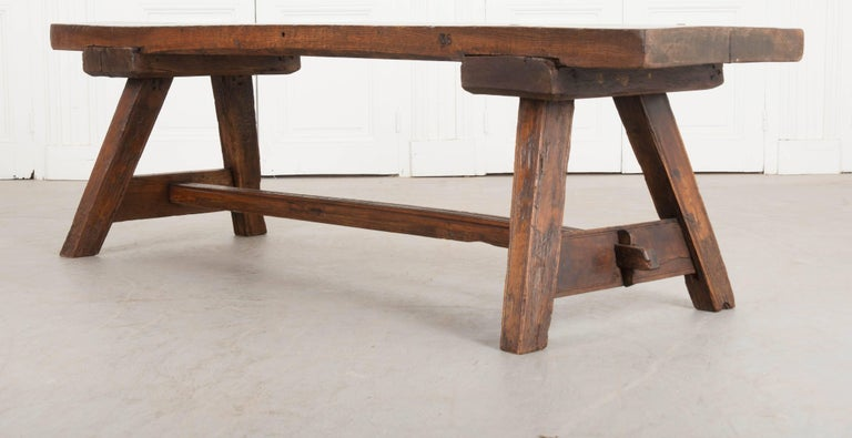 A single solid-oak board was used to make the top of this incredible 19th century English bench. The bench was made in the English countryside, circa 1830. The top is worn, with evidence of countless bottoms resting momentarily before going their