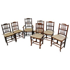 English Early 19th Century Set of Seven Crested Spindle Back Dining Chairs