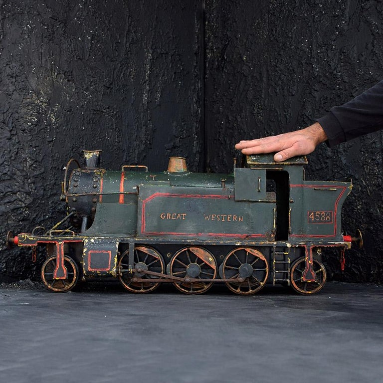 Amazing scratch built locomotive  We are proud to offer one of the best examples of English early 20th century scratch built Folk Art examples. Modelled on an English steam locomotive this item has been wonderfully constructed using metal sheets