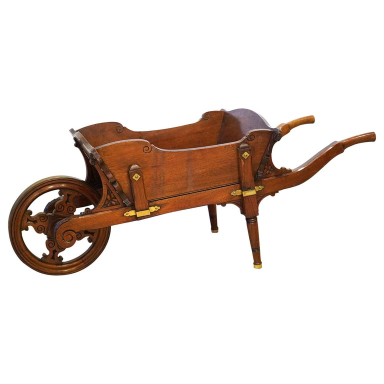 English Edwardian Carved and Brass Mounted Mahogany Library Book Wheel Barrow For Sale