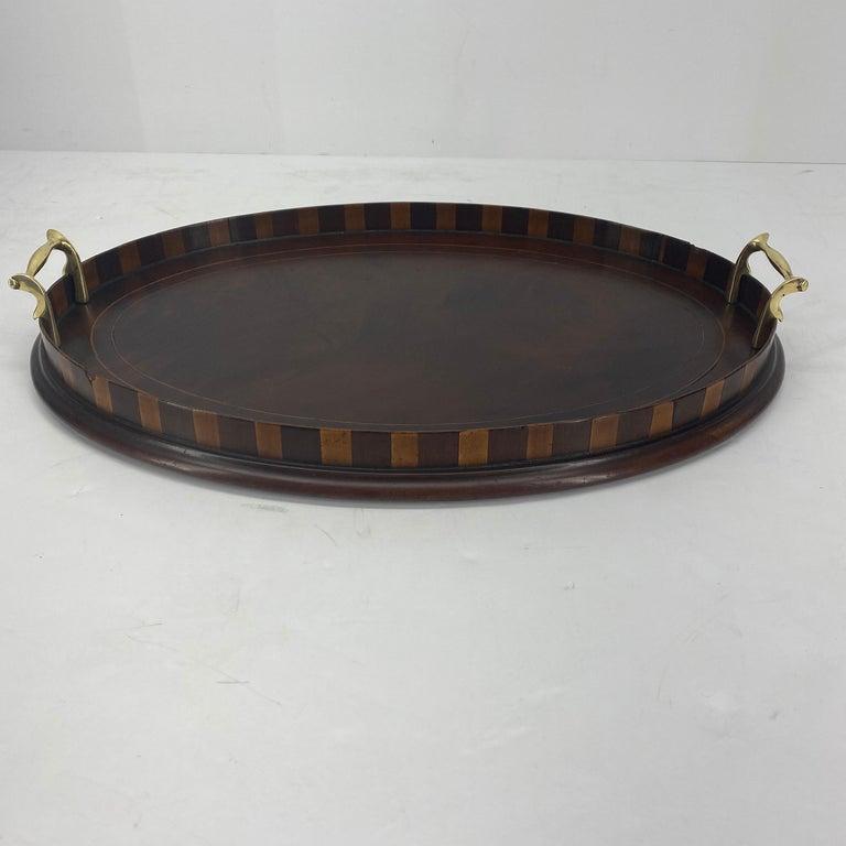 Small oval Edwardian mahogany and citrus inlaid bar tray with original brass handles.