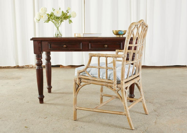 Rustic pine writing table or desk featuring thick turned legs. Made in the English Edwardian taste with a two drawer case. Finished in a dark stain on the pine. Ample leg room measuring 24 inches from the floor to the apron. From an estate in San