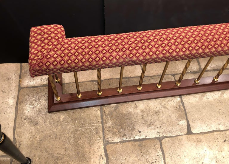 English brass and mahogany U-form fireplace surround with an upholstered seat cushion top.