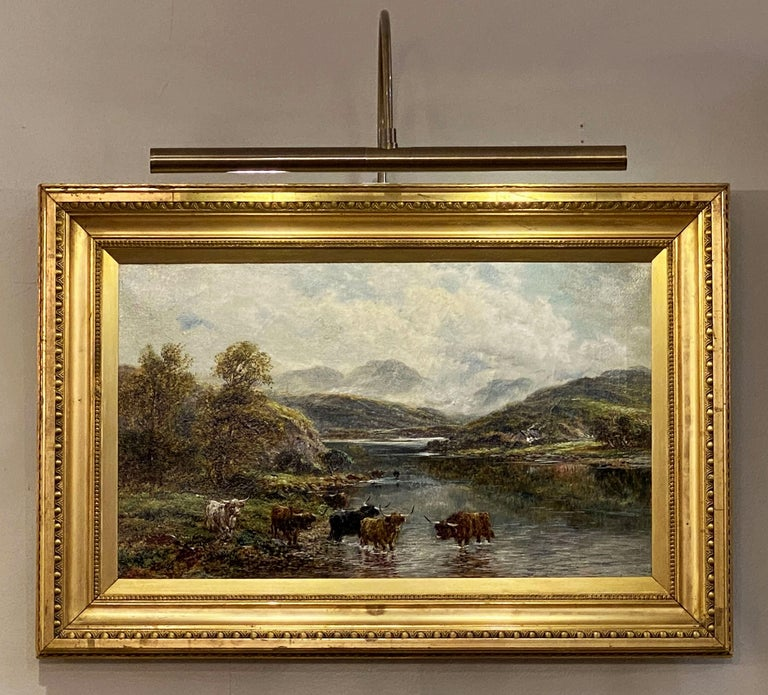 A fine rectangular English oil painting on canvas in a giltwood frame, featuring a highland river landscape with watering cattle.  Signed: Andrew Lennox  Dimensions: H 17 1/4 inches x W 25 1/2 inches x D 1 3/4 inches.