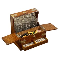 English Gaming Compendium and Tantalus of Oak with Three Decanters