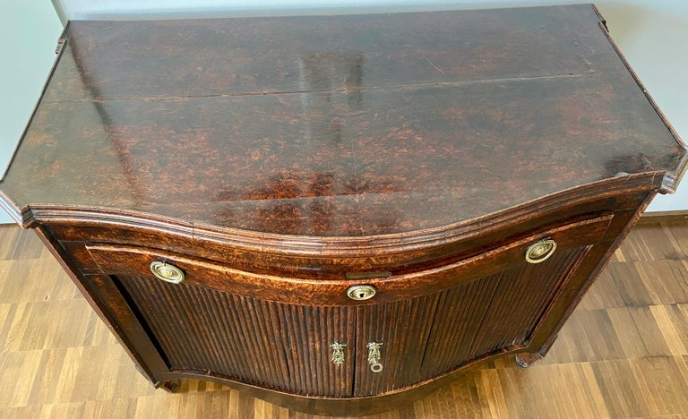 Dutch Burl Mahogany Commode/Sideboard, Late 18th Century  The mahogany commode has a serpentine design that includes a drawer and cabinet below. When you lift open the top, the commode transforms into a bespoke sideboard. The sideboard mode extends