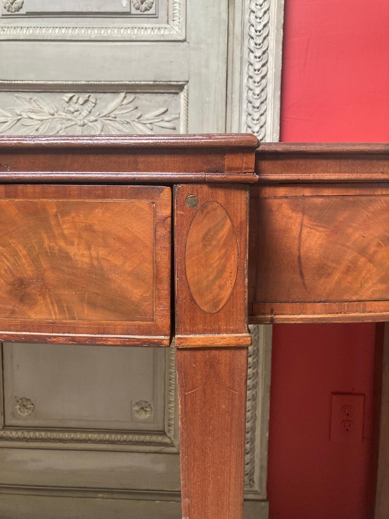 An early 19th century George III mahogany sideboard, server with three drawers and a beautiful plum pudding mahogany top.
