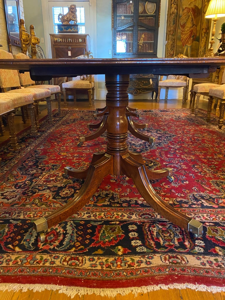 English mahogany George III three pedestal dining table with two leaves. Each pedestal is 26.75