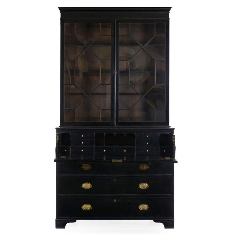 A finely crafted secretaire situated as a bookcase over a chest of drawers, the upper drawer is