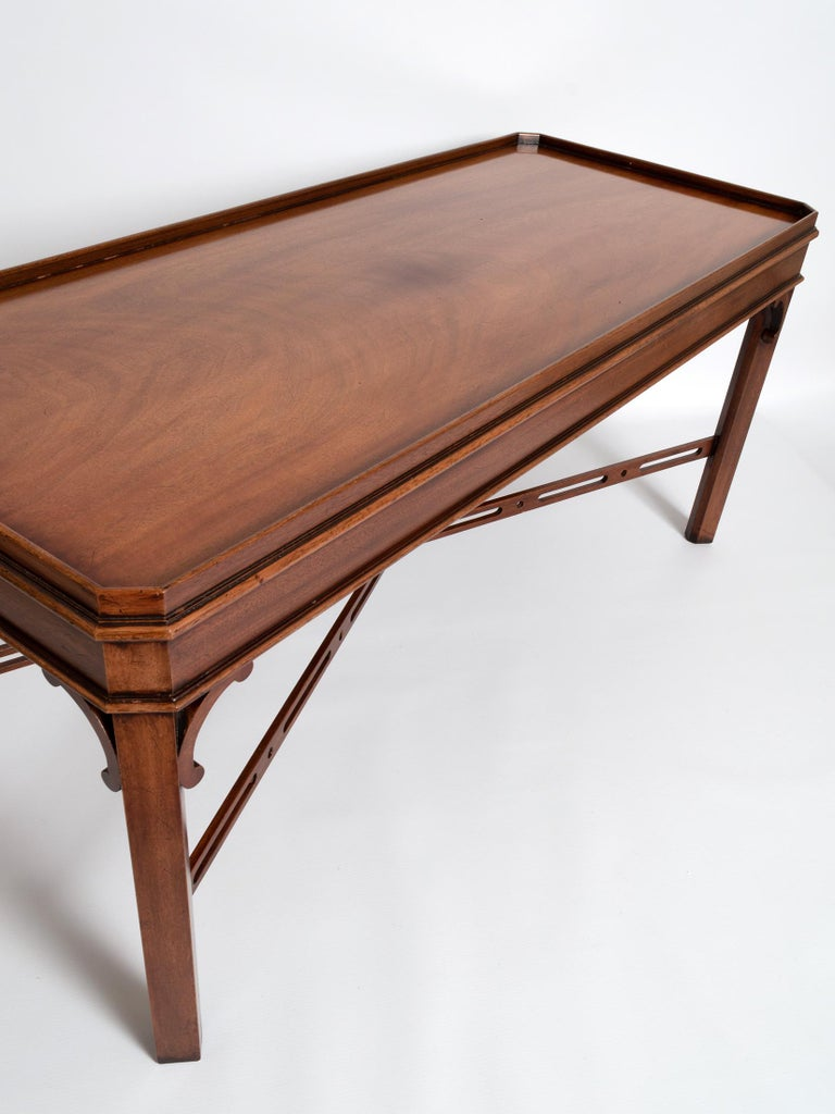 A solid mahogany George III Chippendale style coffee table by the fine English cabinet makers Brights of Nettlebed.  A fine piece with attractive fretwork detailing.  In very good condition commensurate of age and use.